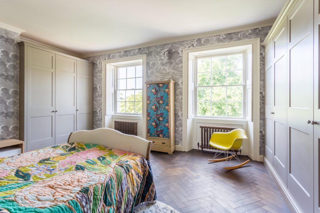 herringbone wood floors in bedroom