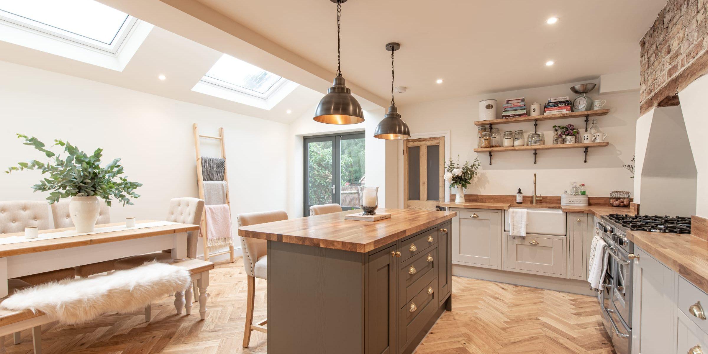 herringbone wood floors in open plan kitchen