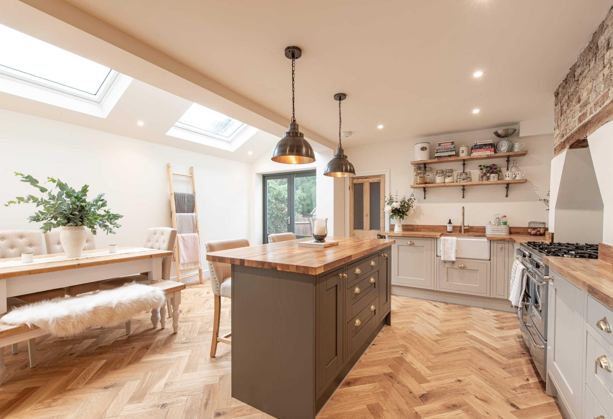 herringbone wood floors in open plan kitchen