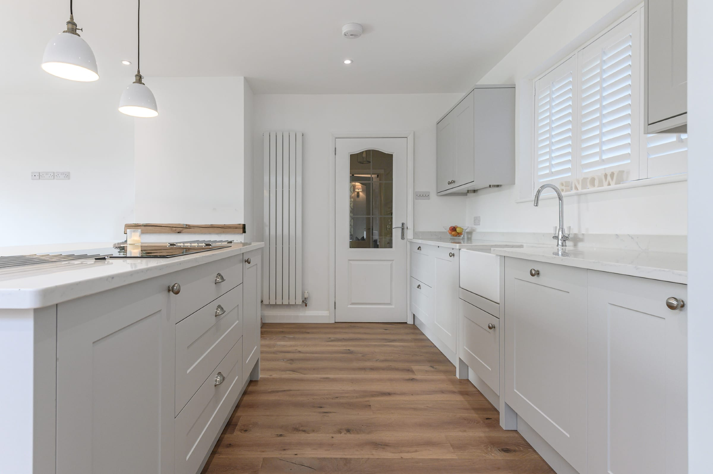 wood floors in a white kitchen