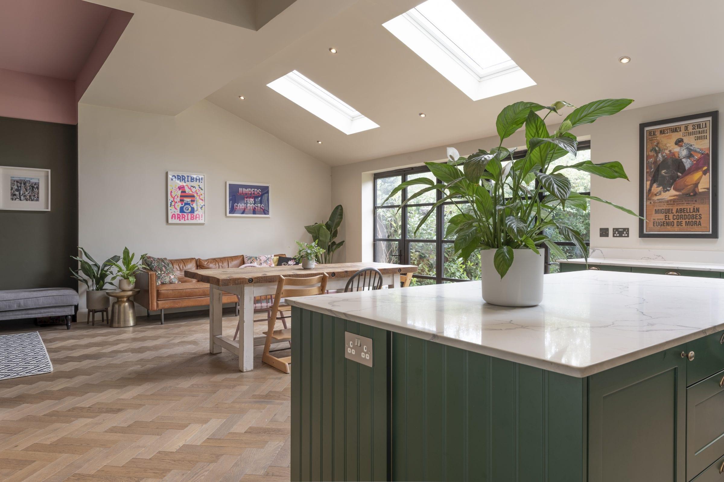green kitchen with herringbone floors