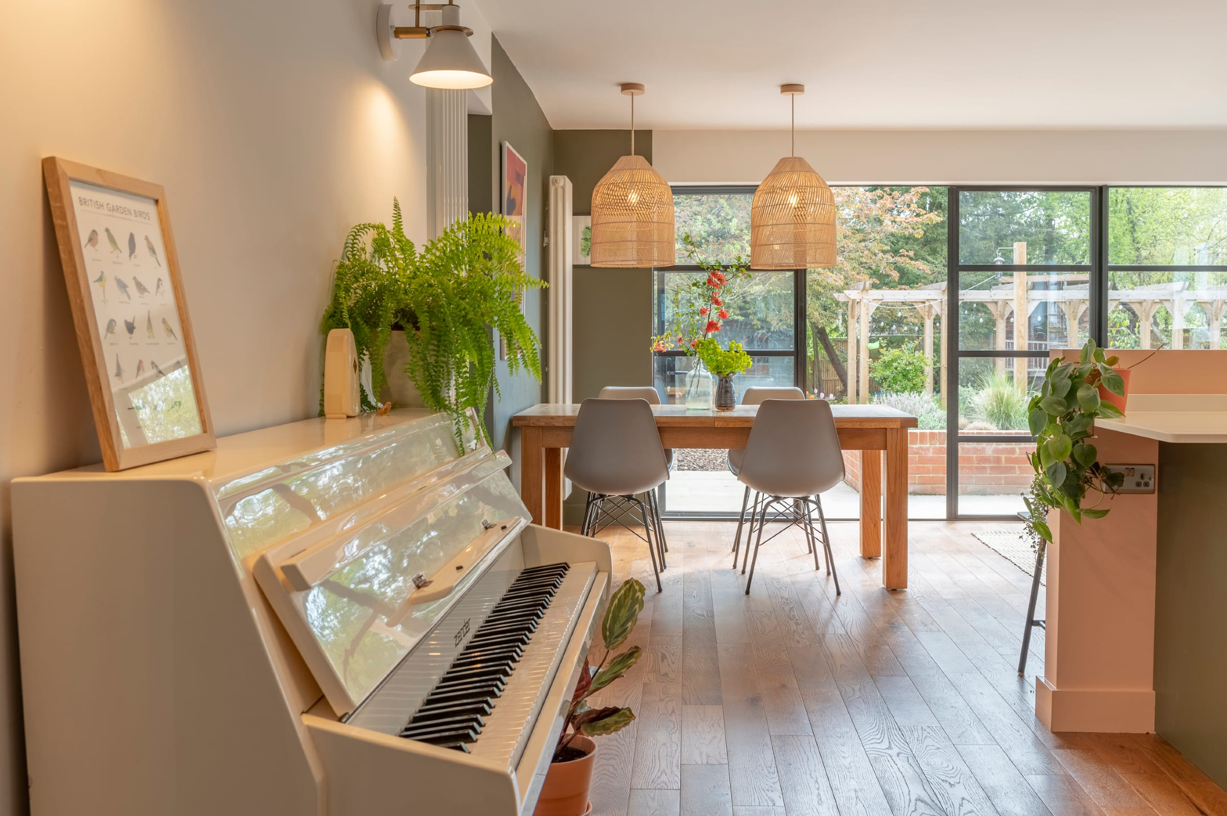 White piano in open plan living space